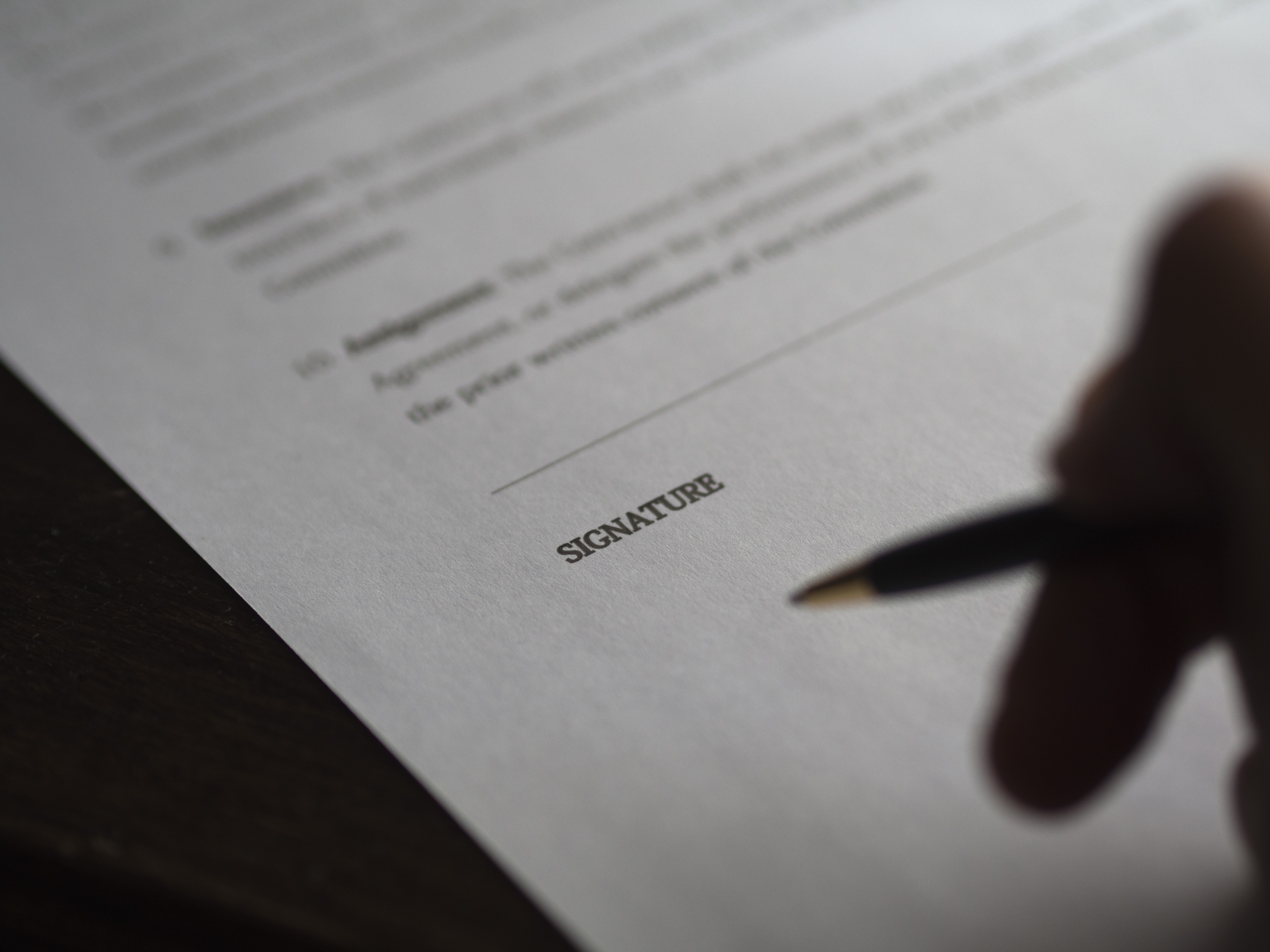 A person signing a document.